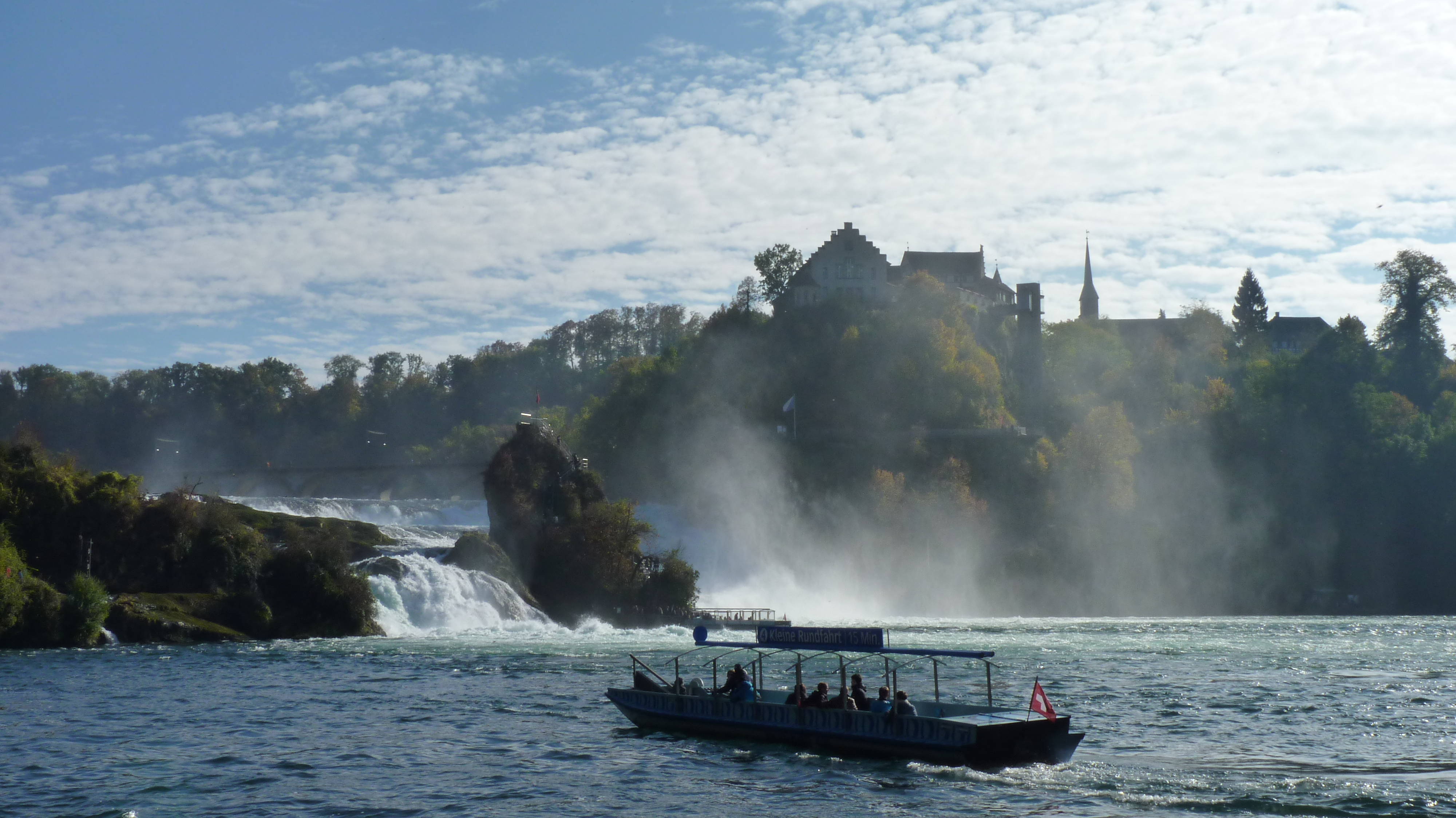 View from the Rhine river bank on the Falls and Laufen's castle