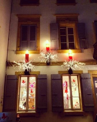 Window of a house in Morat, decorated with Christmas ornaments
