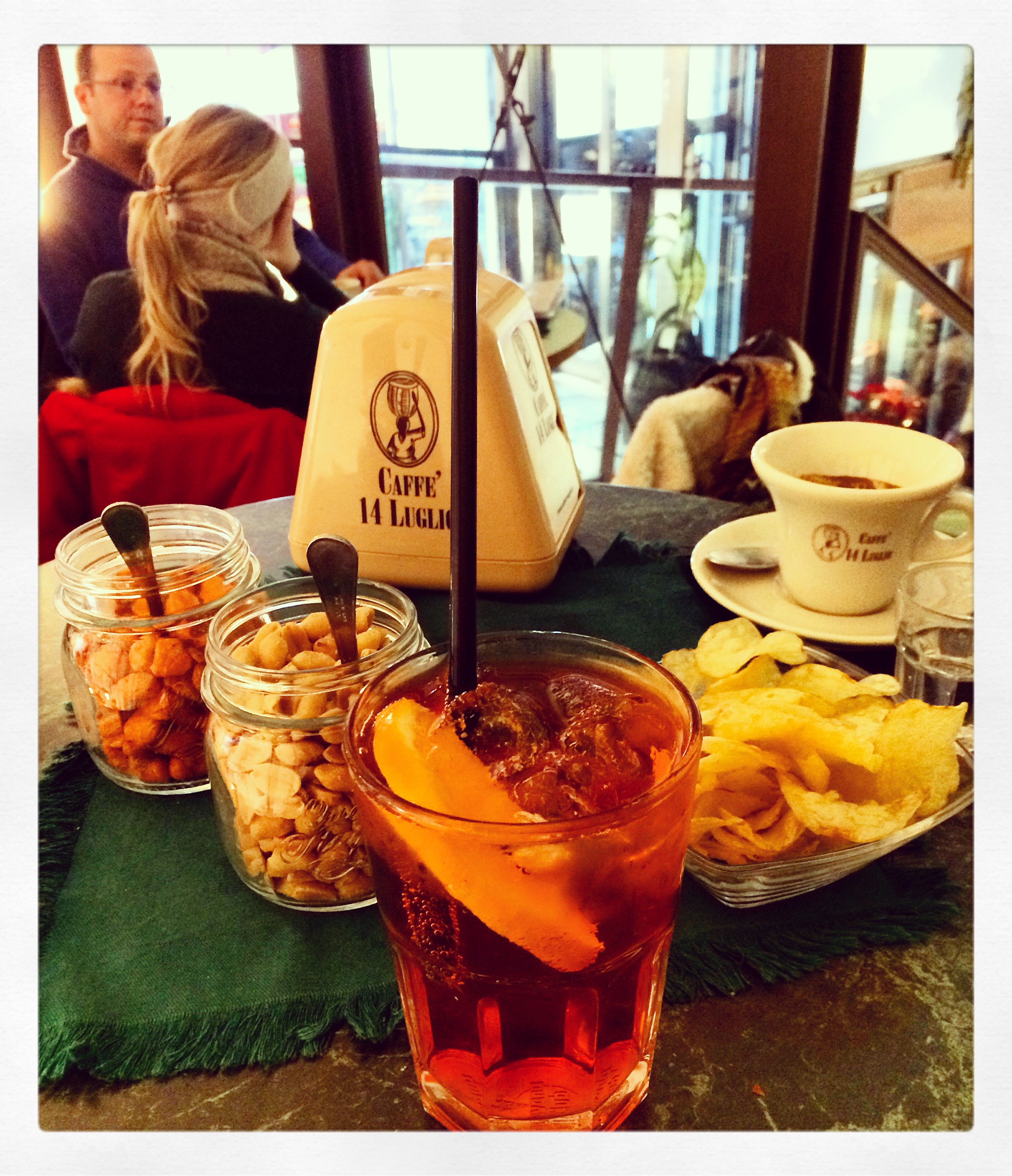 Picture of an Aperol Spritz and nibbles in Bologna