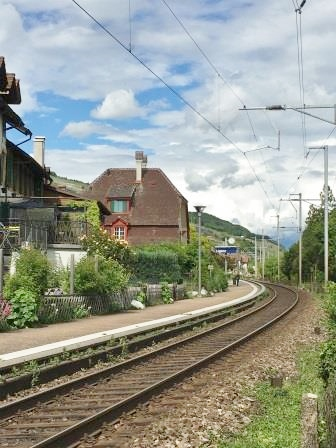Train station of the village of Ligerz with close up on railroads