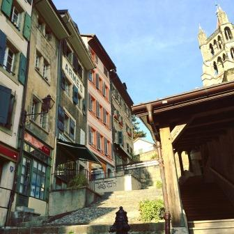 City view of the pastel medieval houses of Lausanne old town