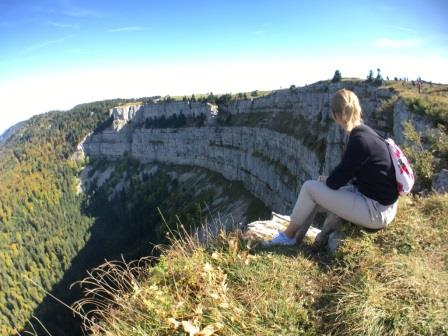 Female blogger Heidi Goes Travelling contemplating the Creux du Van