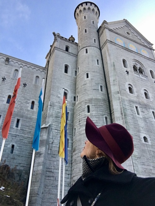 Female blogger Heidigoestravelling looking at Neuschwanstein castle from right below and close-up