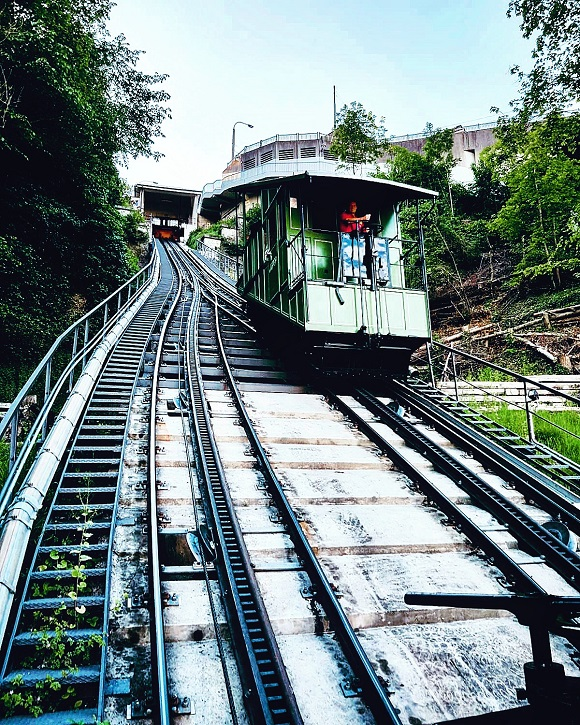 Railway of Fribourg's tiny funicular and one of its single green wagon