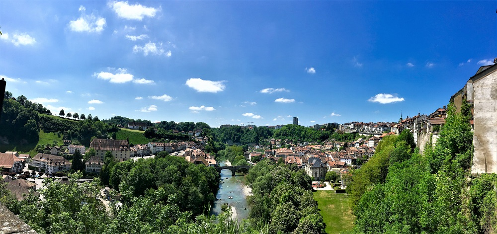 180° view of the city of Fribourg old town and the Sarine River flowing in the middle.
