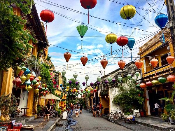 6 reasons to visit Vietnam lanterns hanging above the street Hoi An