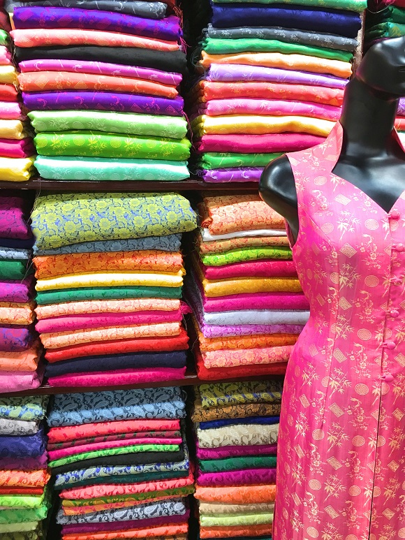 6 reasons to visit Vietnam tailor made clothes Hoi An