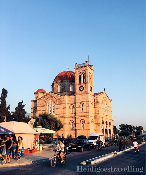 Honey-coloured Greek orthodox church building on Aegina's waterfront