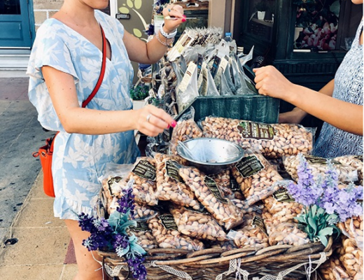 Female blogger Heidigoestravelling tasting pistachios