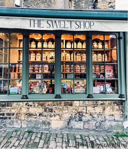 Picture of steel-green coloured shop window featuring old-fashioned candies