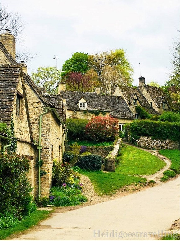 Picture of tiny stone cottages bordering a street