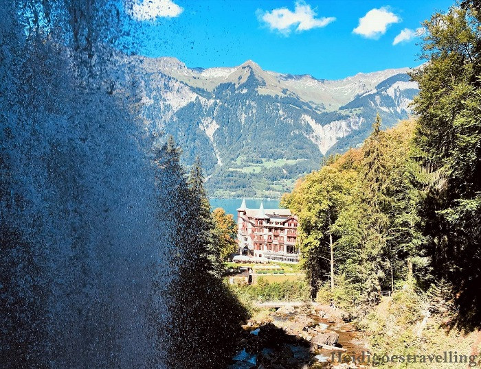 View of the Grand Hotel Giessbach from behind the waterfall