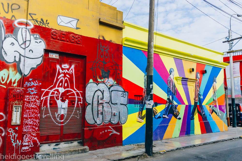Two small building covered with colourful street art