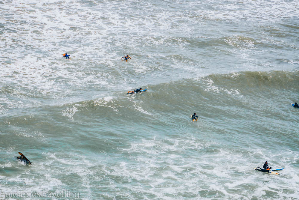 Close-up view of surfers surfing the Pacific ocean