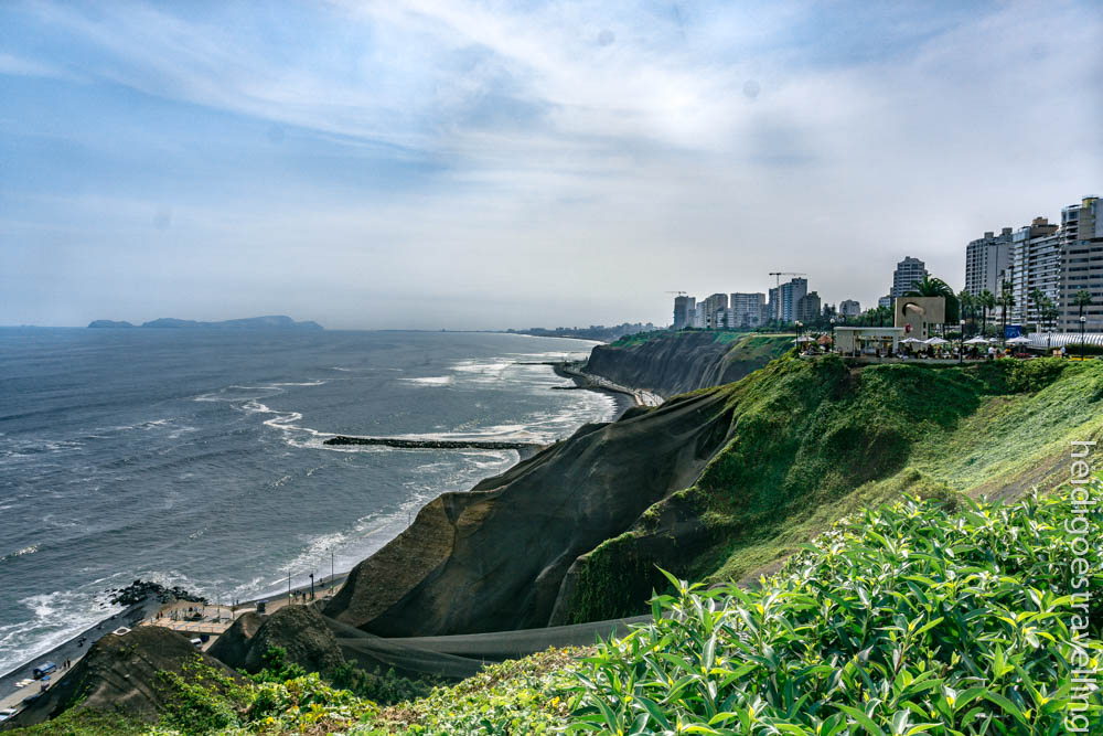 View on Lima and the Pacific ocean from very steep green cliffs