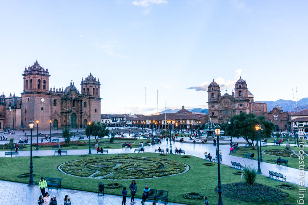 360 view of Cusco's main square surrounded by two massive pink stone churches