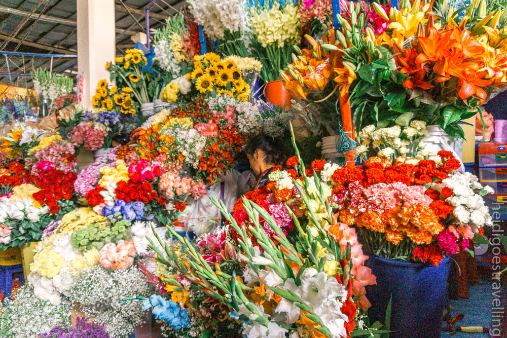 Market stall in the covered San Pedro Market in Cusco, selling flowers