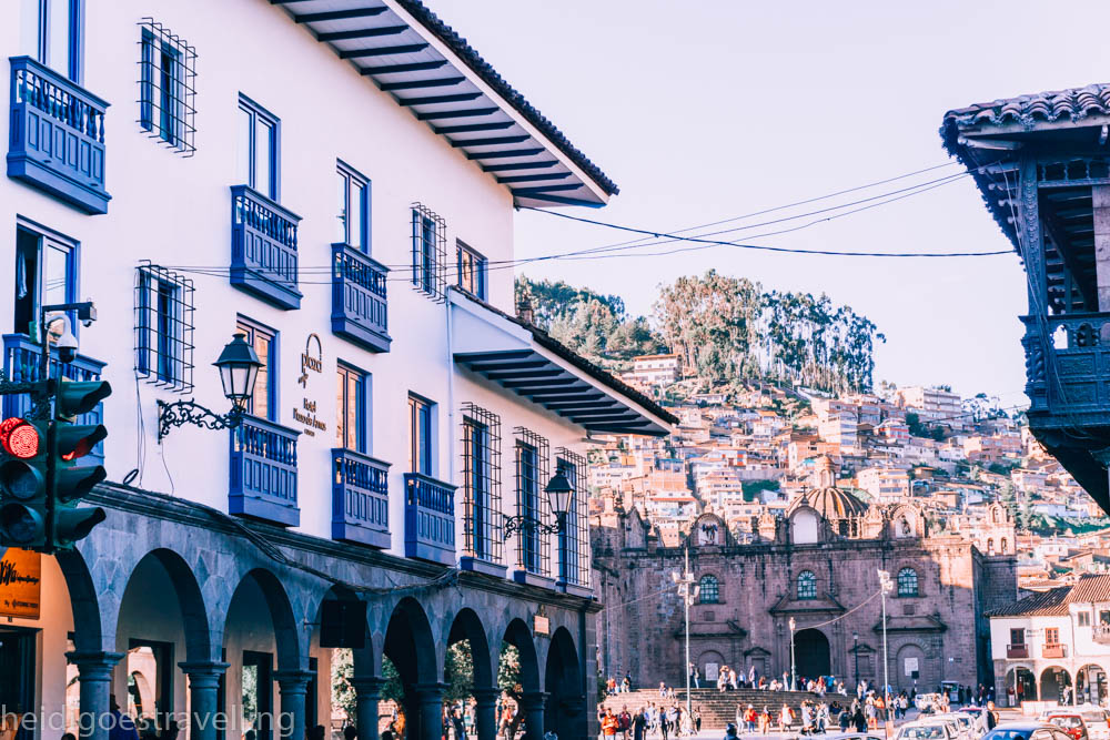 Picture of a traditional white washed with blue balconies Cusco colonial house