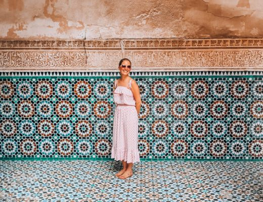 Young blonde woman standing on blue and turquoise mosaics