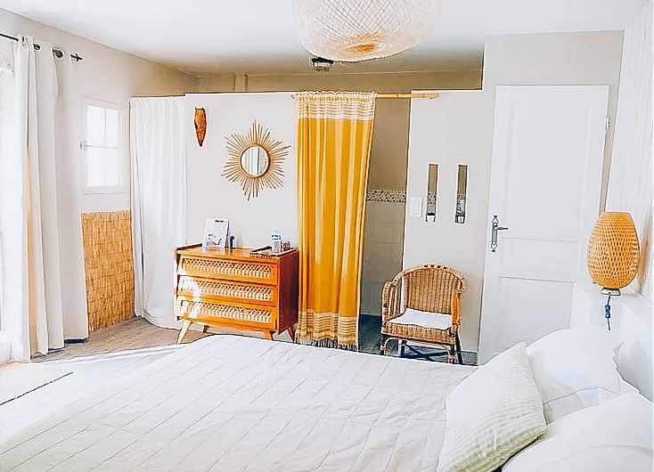 Picture of a bedroom including one king size bed and rattan furnitures