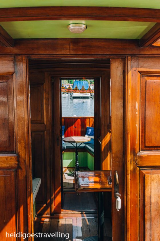 Picture of the inside of an old saloon boat all with wooden panels