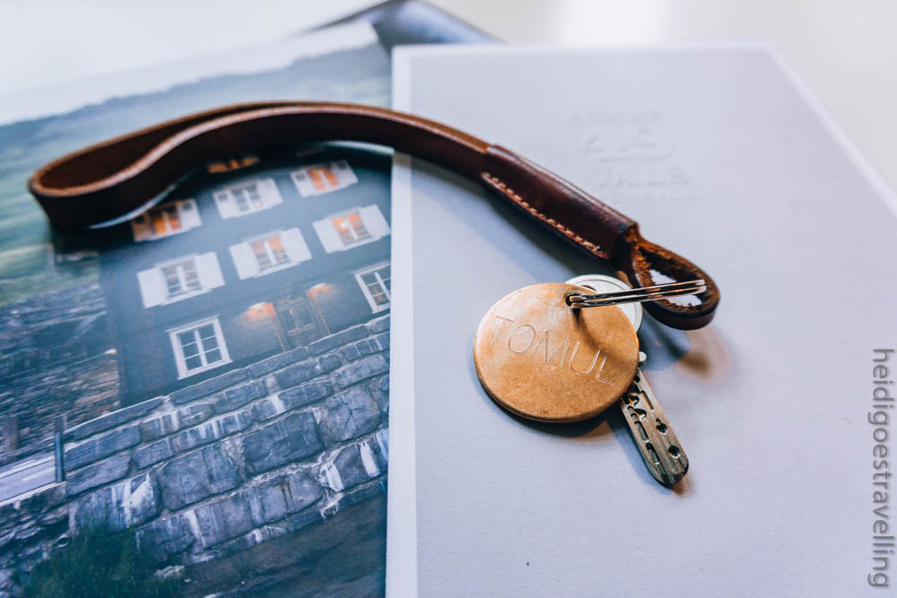 Picture of a hotel room key with a leather key chain
