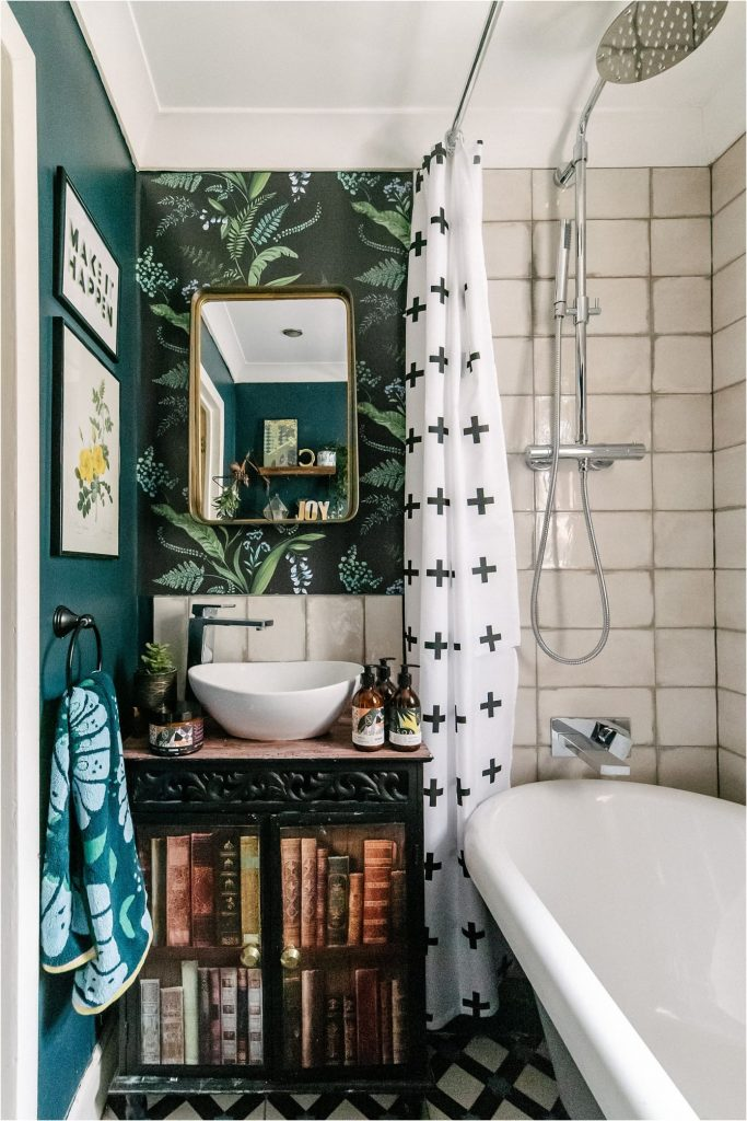 Picture of a small white and teal coloured bathroom