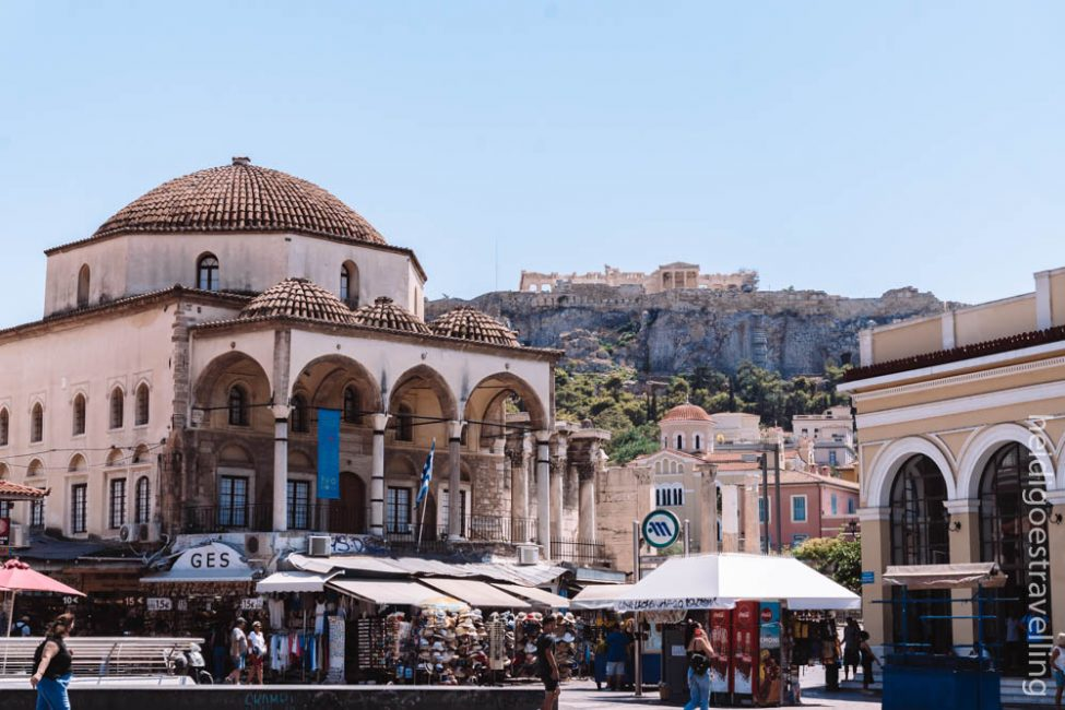 Picture of an old Byzantine church in the foreground and the Acropolis in the background
