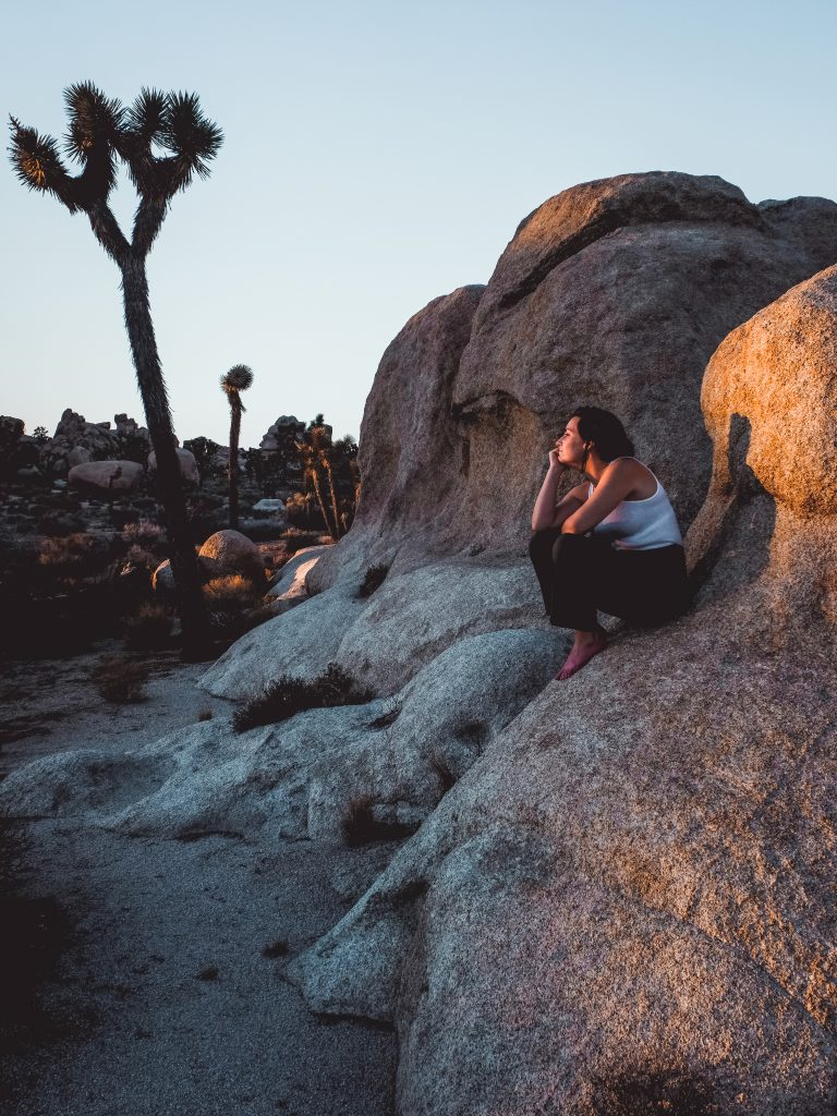 Young woman sitting on a rocky formation