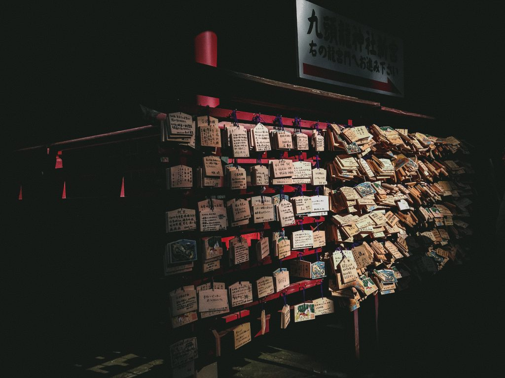 Picture of a prayer tablets wall inside a temple